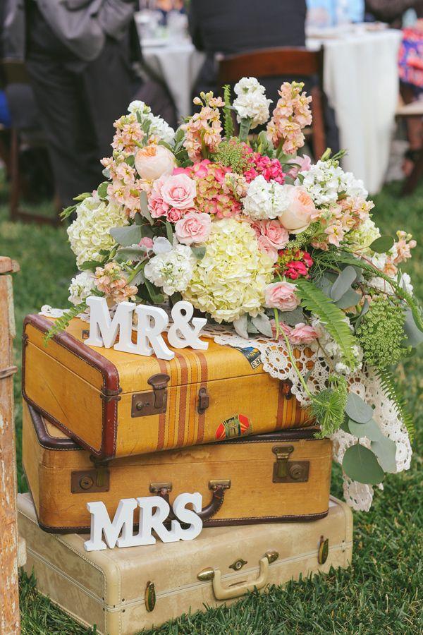 suitcases as wedding decor - photo by Priscila Valentina http://ruffledblog.com/bohemian-wedding-at-secluded-garden-estate