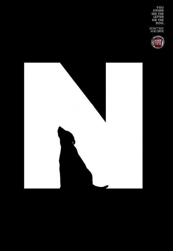 artist - http://www.downgraf.com/  dog creates the negative space to make it look like an N. very nice