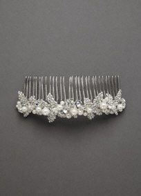 An updated version to the classic crystal and pearl comb.Wear as a traditional side comb or at the crown of the head as a mini tiara. Pair with any of our luxurious velis for a polished look!     Elegant comb/mini tiara embellished with swarovski and czech crystal encrusted leaves and accented with a mixed variety of pearls.  Price   Available in Silver.