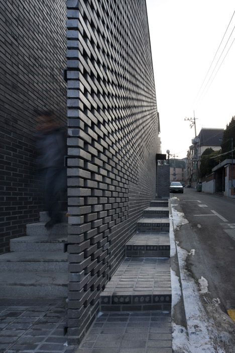 Perforated brick walls front this Seoul office block. pierced wall, screen wall, perforated wall, masonry wall openings, privacy wall