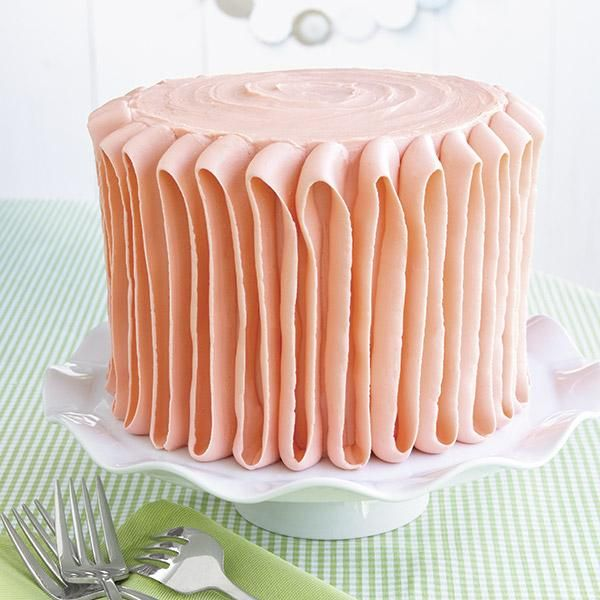 [Plush Orange Ribbon Cake] A luxurious ribbon of icing in a cool shade of orange gives this layer cake a soft and tempting appeal.