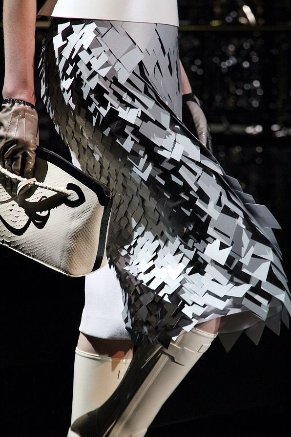 Dtailed geometric futuristic 'chain armor' skirt #evatornadoblog #mycollection…