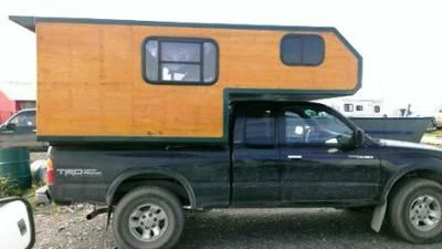 Homemade Pickup Camper: Isn't this homemade camper neat and tidy looking? That's one of the first things I noticed about it. It's not hacked together like some do-it-yourself