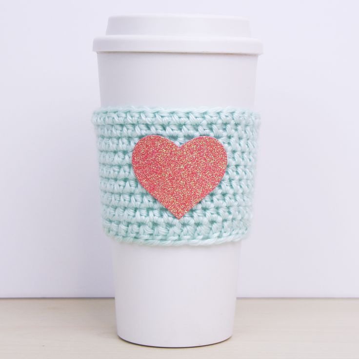 "C O Z Y  The GOOD HEART Cozy is a beautifully crocheted cozy featuring a glitter heart applique in Coral. When the cozy is removed from the packaging sleeve an encouraging message is revealed reminding the recipient ""No beauty shines brighter than that of a good heart"".C H A R A C T E R I S T I C S >> fits standard coffee cups, mugs"