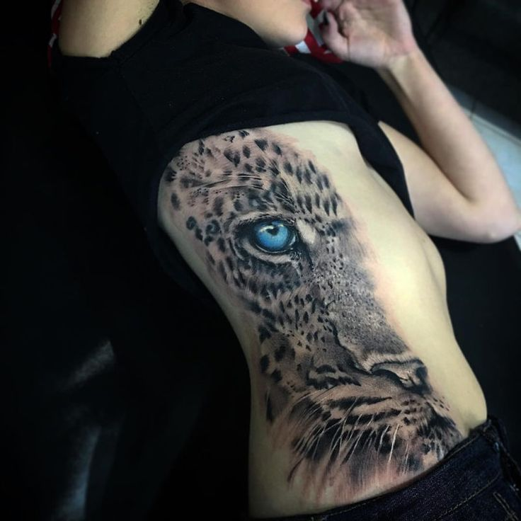 TATTO IDEAS & INSPIRATIONS Cute leopard with pretty blue eyes, done on girl's side by Moses Savea, an artist based in Australia.
