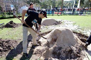 David Beaumont, City of Sydney community engagement coordinator, digs an earth oven in Hyde Park as part of Naidoc week.