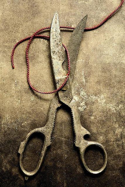 brown. rusty scissors and thread. hdr