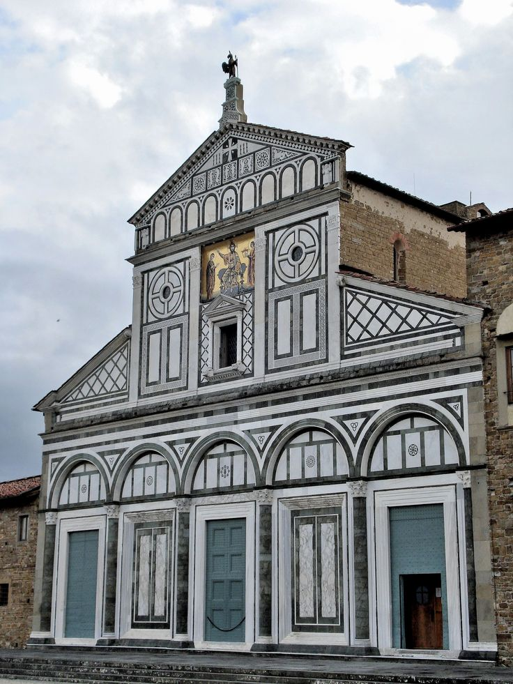 ROMANESQUE ARCHITECTURE, Italy - The Basilica of S. Miniato al Monte, 1062.  The geometrically patterned marble facade of the  was completed in 12th century. It is located at the top of one of the highest points in Florence. The Baptistery and church of S. Miniato al Monte are the prinicipal monuments of Florence's Romanesque architecture.