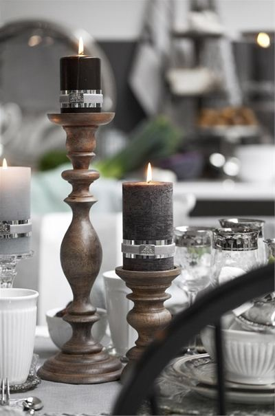 Pretty decorative wooden and silver candles