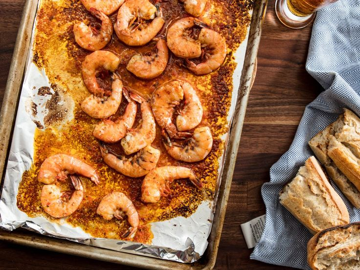 Harissa and Beer Broiled Shrimp Recipe | The resulting butter and beer sauce is begging to be mopped up with crusty bread. You won't even need a plate for this one, just dig right into the piping hot skillet.	  #fathersday #fathersdayinspiration #seriouseats #recipes #shrimp #seafood #beerrecipes