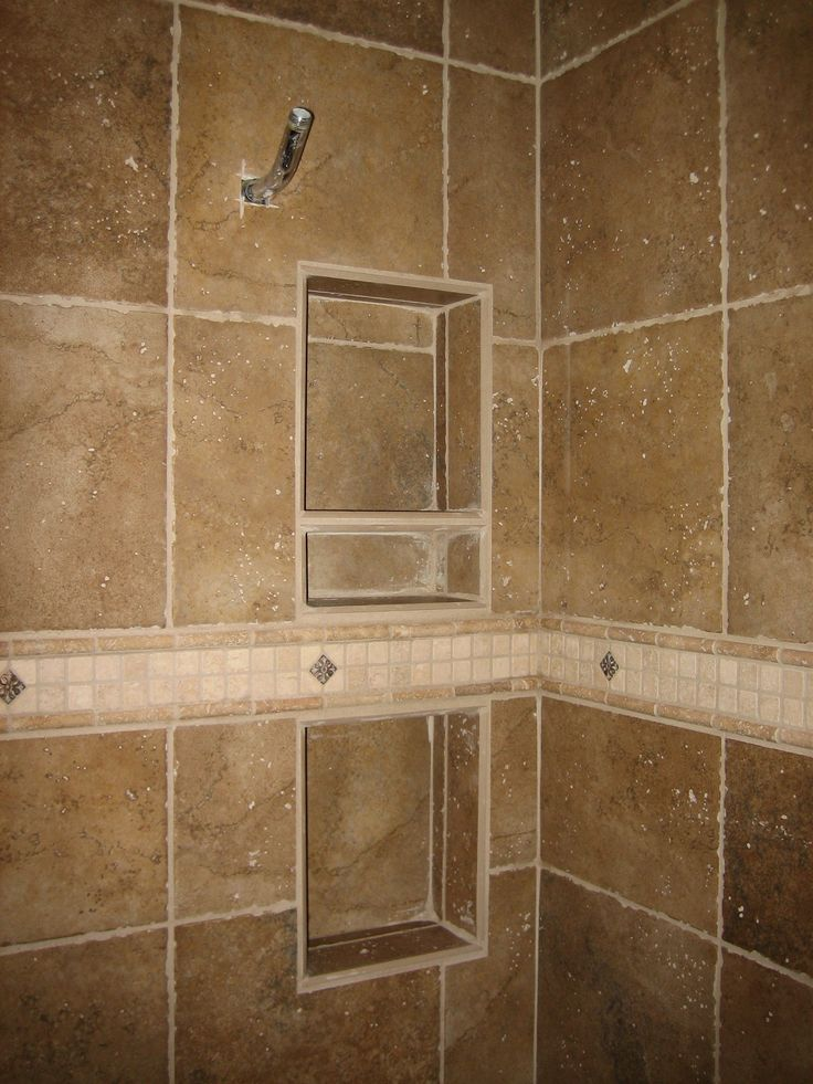 Shower recessed tiled shelving and specialty band best for Brown tile bathroom ideas