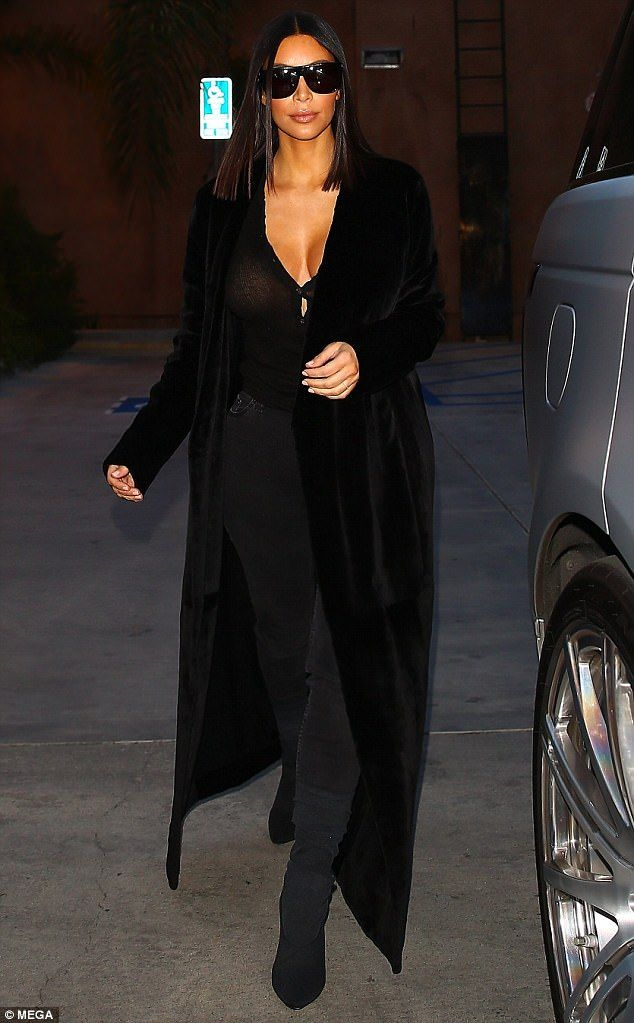 Stylish mommy: The mother-of-two was ultra chic during her outing, donning a floor-sweeping coat and cleavage-baring top