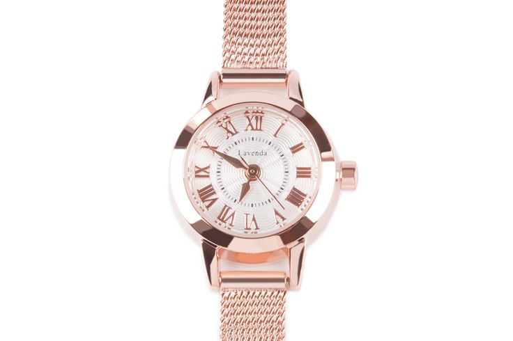 Luna Pyxis small dial rose gold Milanese strap metal watch with roman numerals.