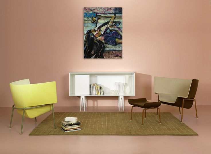 Modern interior of living room with Italian armchairs, contemporary painting of a woman - 'Supergirl 1' by @anialuk_art