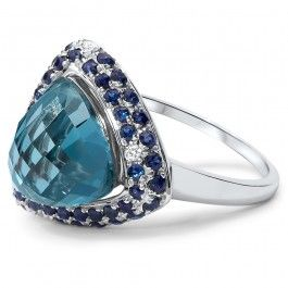 18ct White Gold Sapphire Diamond Cocktail Ring. A truly very large and bold cocktail ring. Meant to catch anyone's eye at any occasion. It features a large genuine natural London Blue Topaz @ 6.7 ct and is enhanced by 82 natural Sapphires and 46 Diamonds