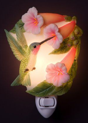 "Hummingbird & Trumpet Vine Night Light Ibis & Orchid Flowers of Light by Ibis & Orchid Nightlights. $13.49. Our extensive collection of nightlights are truly inspired by nature, beautifully sculpted, cast in bonded marble, and expertly hand painted to provide a lasting accessory for your home or a wonderful gift. Each light is nicely gift boxed, complete with bulb and approximately 3"" x 6"". UL Listed.. Save 50%!"