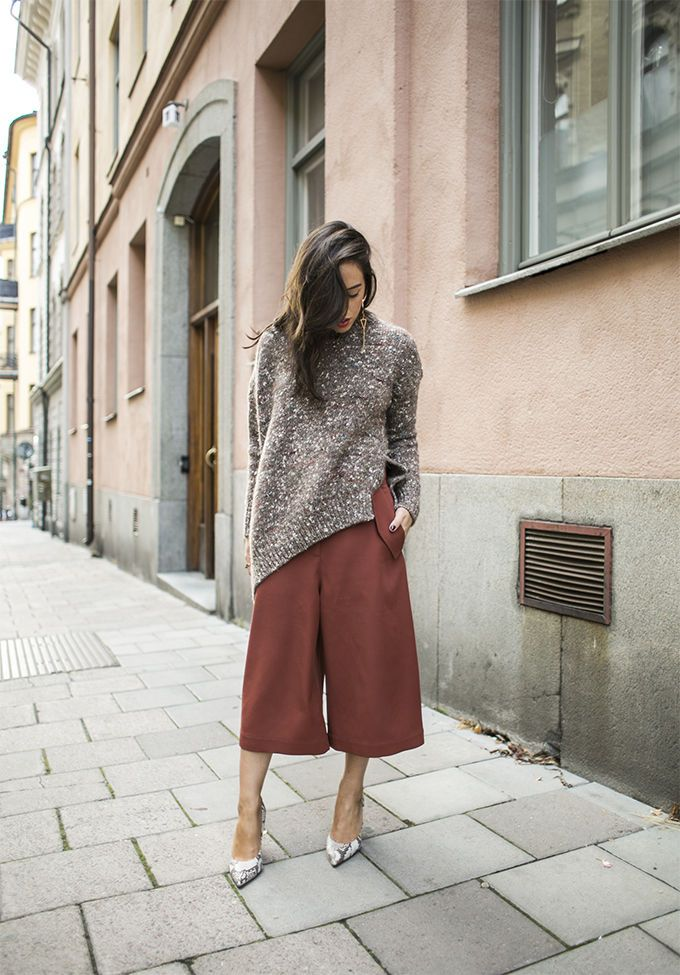 Rose culottes and loose sweater. Long hair.