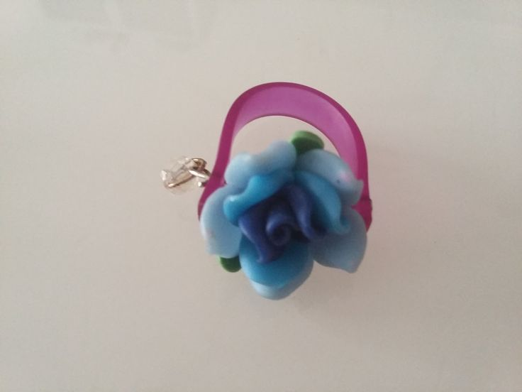 caoutchouck flower ring by aggelinokosmos on Etsy