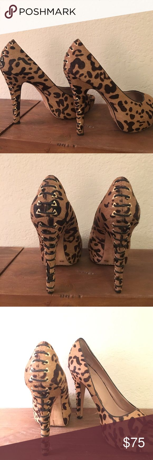 Vince Camuto Cheetah print lace heels Vince Camuto cheetah hair lace heel stiletto. 1 inch platform, 4 inch heel. In great condition!! Barely worn. Back lace up detail in black and gold. Vince Camuto Shoes Heels