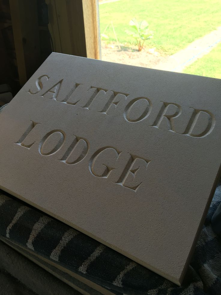 Andrew James hand carved letters. Bath stone.