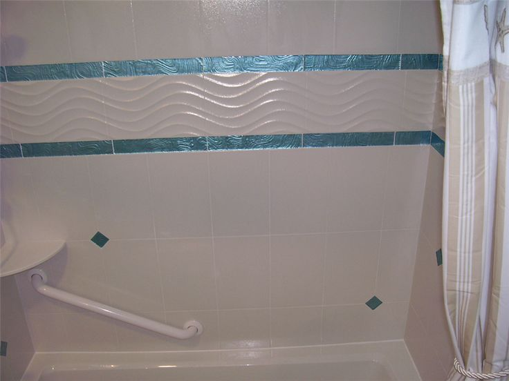White Wavy Tile And Iridescent Turquoise Border Tile Are