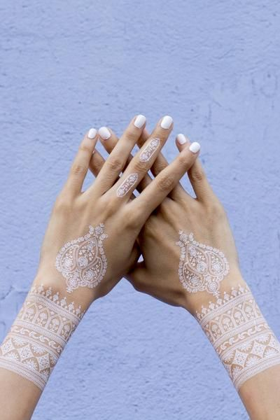 White henna temporary tattoos are the newest trend in body art. They are great for the festival season and are suitable for ALL skin tones. Each set contains 2 sheets with several designs to be used t