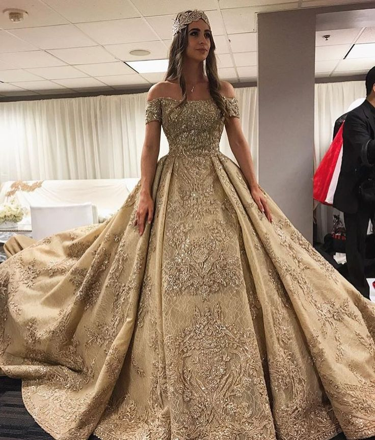 A stunning off the shoulder Zuhair Muhrad intricately beaded wedding gown //  Ever wondered what a $10 MILLION DOLLAR wedding looks like? Russian tycoons' daughter Lolita Osmanova and Gaspar Avdolyan's wedding was one that spared no expense - it was a lavish celebration that featured a 10-tier wedding cake, $500,000 worth of floral decor, and a star-studded performance by Jason Derulo and Lady Gaga!