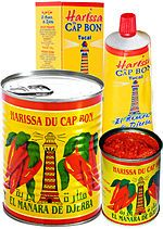 Tunisian Harissa sold in cans and tubes///Variations can include the addition of cumin, red peppers, garlic, coriander, and lemon juice. In Saharan regions, harissa can have a smoky flavor. Prepared harissa is also sold in jars, cans, bottles, tubes, plastic bags and other containers.