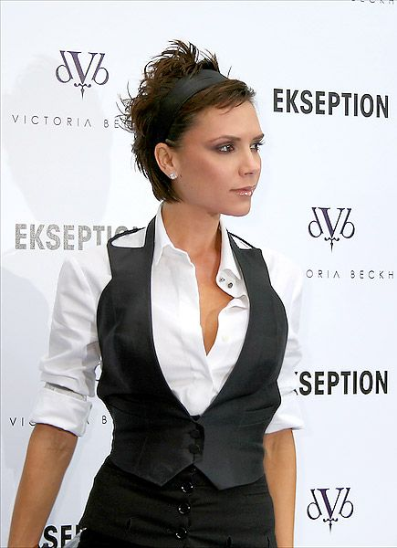 A messy hairstyle like Victoria Posh Beckham's edgy spiked 'do can be a sexy style that is sure to draw attention. Posh accessorizes with a wide hair band that softens the rock chick look with a girly touch.  Get the look: Apply wax or strong-hold gel to damp hair and use fingers to rake and work the hair into spikes. Dry hair using a diffuser, with your head tipped over, and finish with hairspray for extra hold and shine.