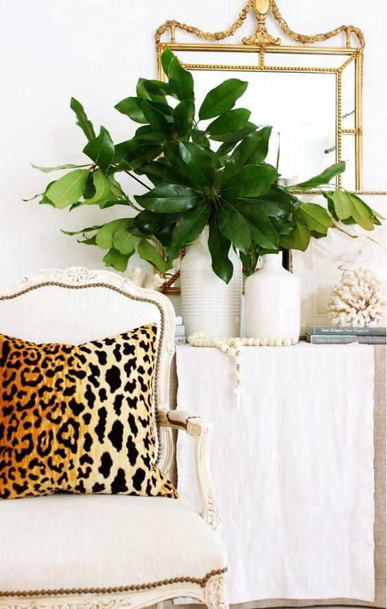 decorating-with-animal-hides-leopard-pillow-chic