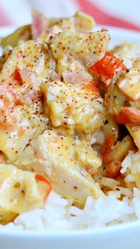 Creamy Cajun Chicken & Rice — I have chicken, I see some heavy cream…Ooo, wine! Let's pull some onions, tomatoes & garlic. Shall we add cheese? Can never go wrong with cheese! Let's spice things up…let's make it Cajun! BAM! Perfect!