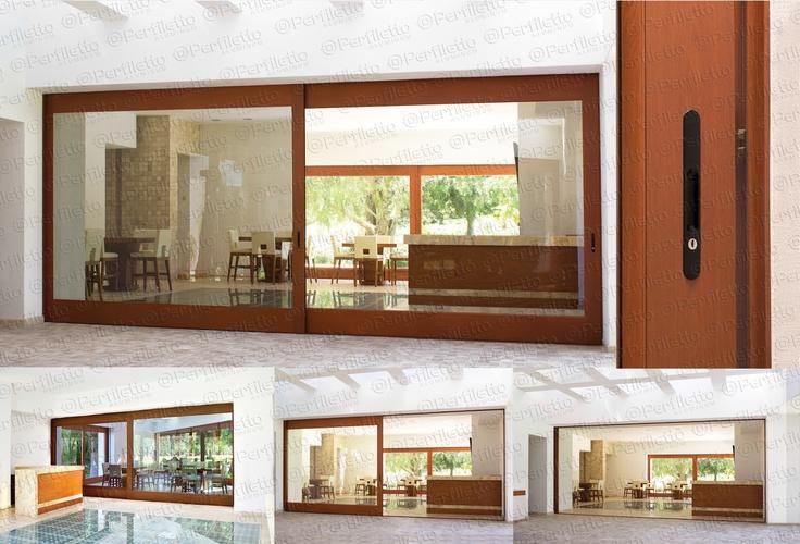 Puerta corrediza ocultable en muro aluminio en acabado - Puertas de aluminio color madera ...