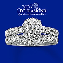 Kay 14K White Gold 2 Carat t.w. Leo Diamond Bridal Set. An eye-catching round Leo Diamond steals the show in this picturesque engagement ring for her. Additional round Leo Diamonds flow along the 14K white gold band. The matching wedding band is awash in round Leo Diamonds for dramatic dazzle. Two carats total diamond weight. Independently Certified and laser-inscribed with a unique Gemscribe® serial number.