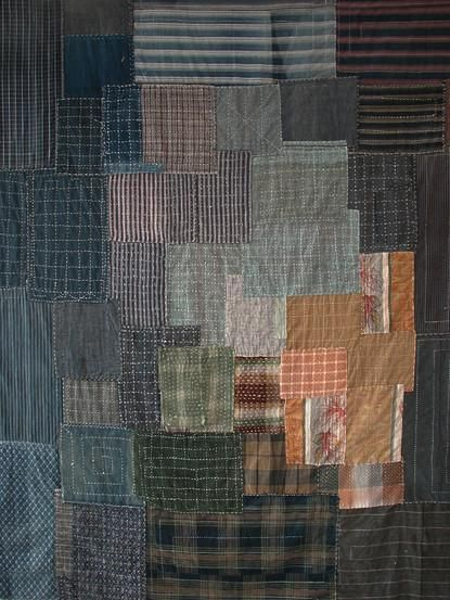 Quilt made from antique cotton cleaning cloths with sashiko stitching.