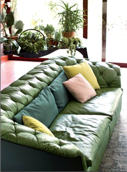 A second hand sofa looking downbeat in an auction or charity shop can be transformed once it is given a good home and some cushions.