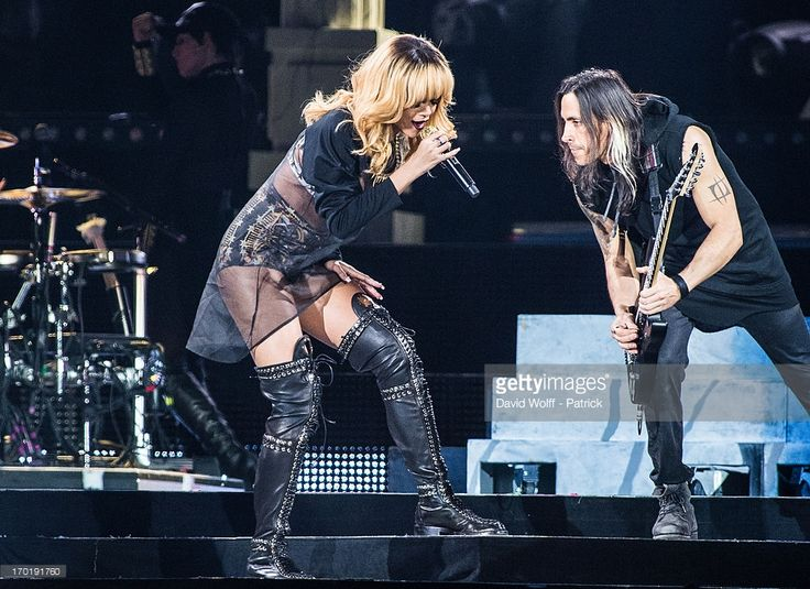 Rihanna and Nuno Bettencourt perform at Stade de France on June 8, 2013 in Paris, France.