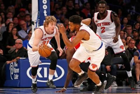 New York Knicks guard Ron Baker (31) drives down court with the ball in the second half of a preseason NBA basketball game at Madison Square Garden.