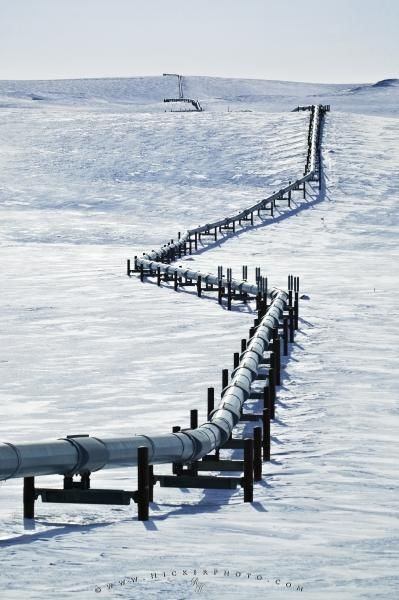 A small section of the 1300 km long Trans Alaska Pipeline, which conveys crude oil between Prudhoe Bay and Valdez in Alaska, is surrounded by snow and ice.