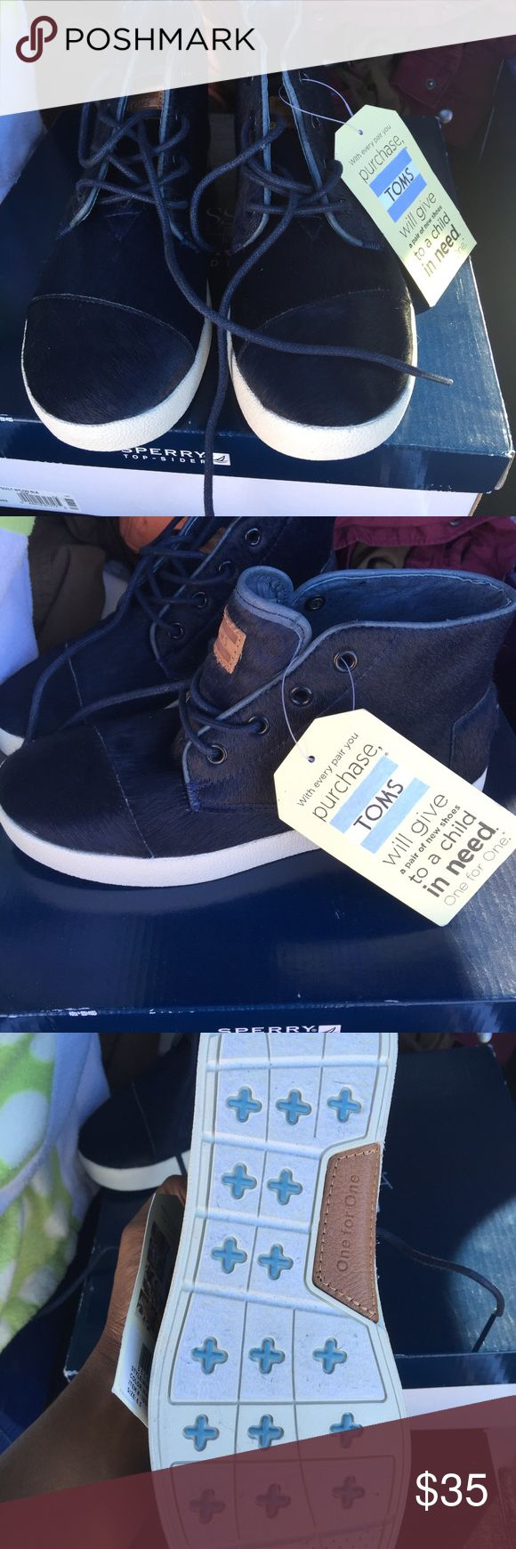 Velvet/Faux Fur Navy Toms NWT Navy Hightop Toms. Have a fur feel to them. Nice for Fall with a cute plaid vest. TOMS Shoes Sneakers