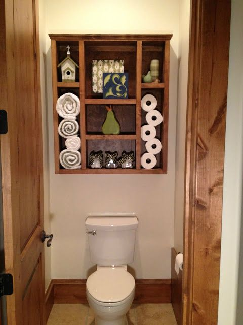DIY bathroom shelves -- i love the idea to put handmade shelves over the toilet