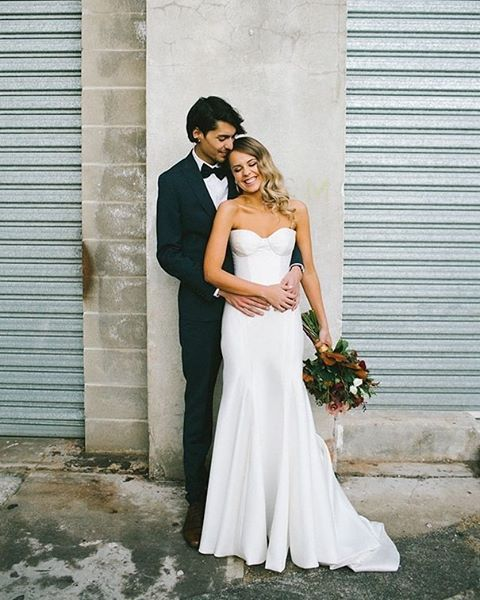 Rachael and Charles's stylish modern wedding is now live on @hellomaymagazine . *** LINK IN PROFILE *** Photography: @kaitphotography Flowers: @bitsandbuds  Gown: 'Prea' @kwhbridal #kwhprea @karenwillisholmes_brisbane