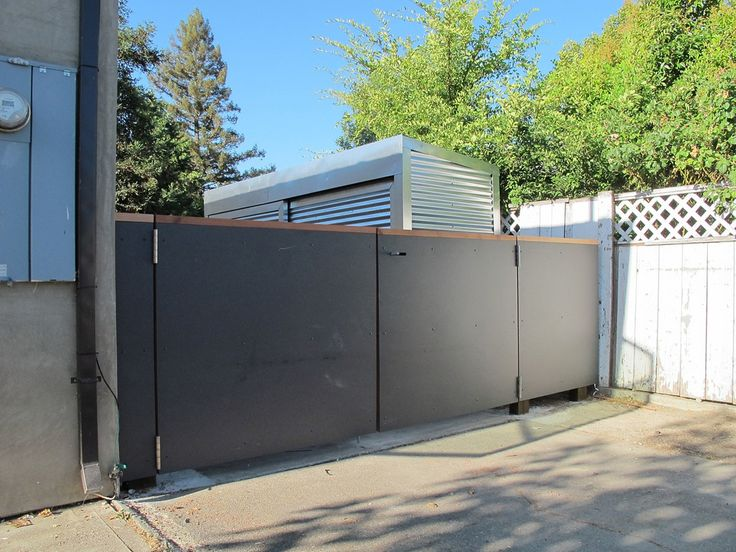 Dark Gray fiber cement boards used as fencing/gate. Studio Ecesis Architects.