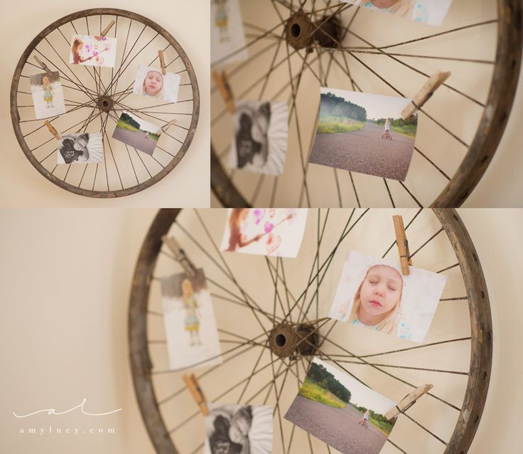 Photo display idea: use clothes pins to clip photos to a vintage wooden bicycle tire. Perfect for Christmas cards, too! by Amy Lucy Photography, www.amylucy.com