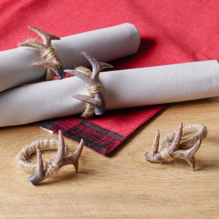 An extremely unusual napkin ring that would look great in a contemporary home, these napkin rings are made from jute string with a resin antler that has been bound to it The resin antler has a distressed finish that gives a realistic look to the piece and the jute string gives the napkin rings a shabby chic feel Due to the distressed finish, each napkin wing will vary slightly in finish and tone, which adds to the rustic feel Supplied as a set of four
