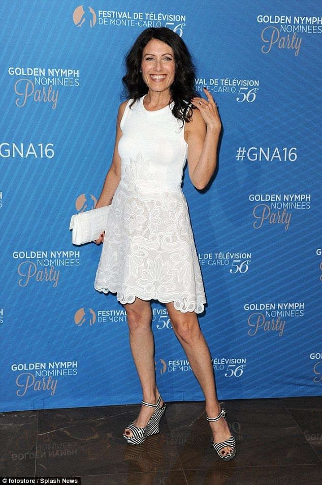 White hot: Actress Lisa Edelstein put on a flirty display in a white mini-dress and striped wedges