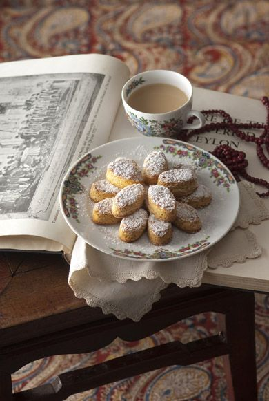 Poor book is a placemat for tea and cookies. Still very elegant.