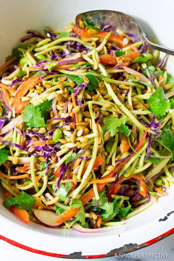 Crunchy Asian Slaw Recipe with Peanut Dressing. A dazzling slaw salad full of color and texture, with a peanut sauce style vinaigrette for a savory sweet