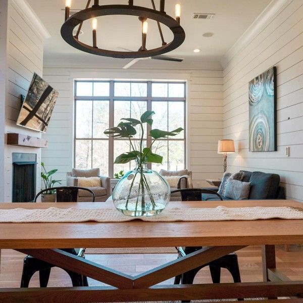 Shiplap walls and a #rustic chandelier complements great dining area decor. Love it! #homedecor @istandarddesign