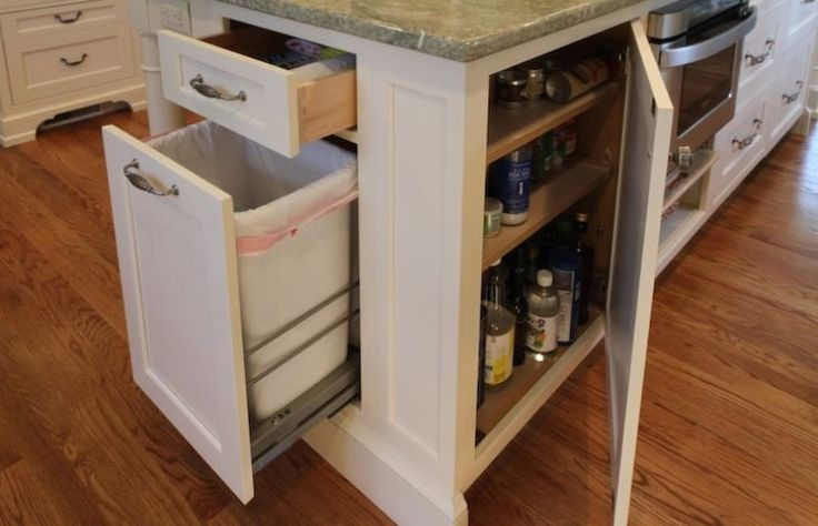 Kitchen Island - utilize this space for both a regular and a recycle slide out trash can.