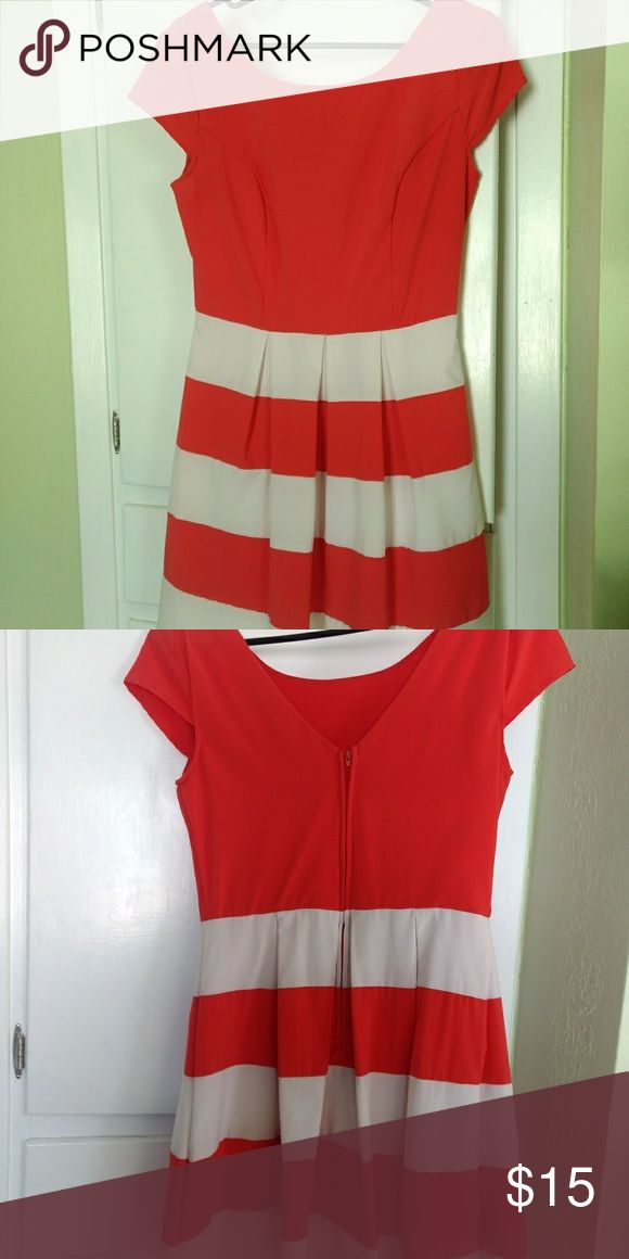 Dress Spring/summer dress. I'm 5'6 and it goes about 2 inches above my knee cap. Size 9/10 Color is white with an orange/pink/coral color. V back. b smart Dresses